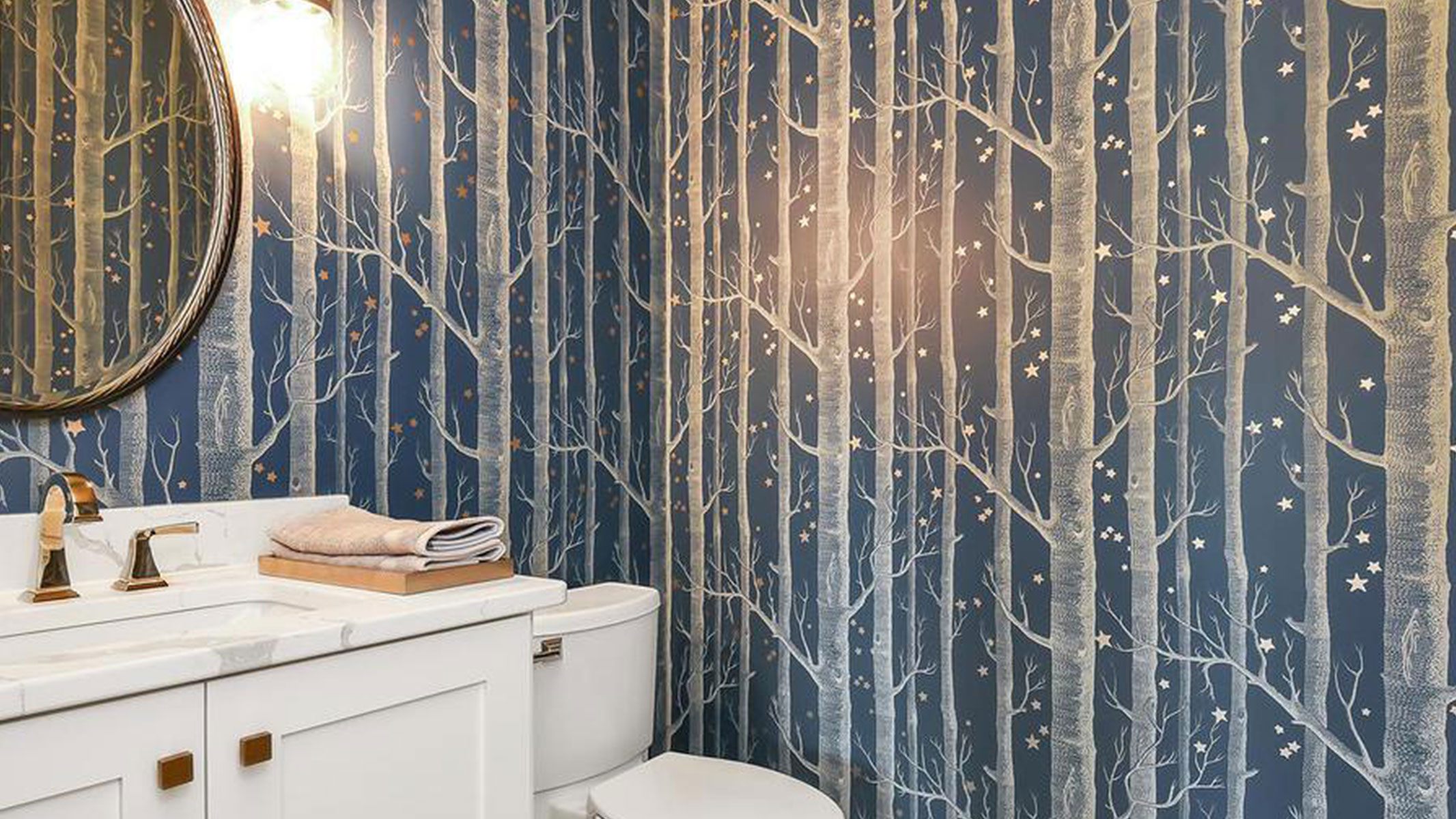 Wallpaper in a bath designed by At Home & Co.